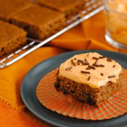 Spiced Applesauce Bars with Pumpkin Frosting - Cake bars made with whole wheat flour and sweetened with agave nectar and applesauce, with a light pumpkin-cream cheese frosting.   foxeslovelemons.com