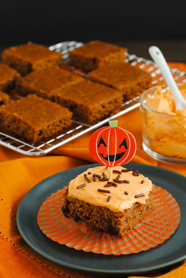 Spiced Applesauce Bars with Pumpkin Frosting - Cake bars made with whole wheat flour and sweetened with agave nectar and applesauce, with a light pumpkin-cream cheese frosting. | foxeslovelemons.com