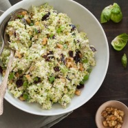 Fruit & Nut Brussels Sprout Slaw - A healthful and tasty coleslaw made with shredded brussels sprouts, dried cranberries and walnuts, tossed with a tangy yogurt-orange dressing! | foxeslovelemons.com