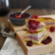 Monte Cristo Party Bites with Raspberry-Malbec Jam - The classic diner sandwich dressed up as a fancy appetizer! Griddled sandwiches filled with ham, turkey and fontina cheese, with a side of homemade jam for dipping! | foxeslovelemons.com