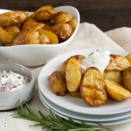 Super Crispy Roasted Potatoes with Shallot-Rosemary Yogurt - A simple technique for roasting potatoes that makes them SUPER crispy and delicious. Plus, a savory dipping sauce!   foxeslovelemons.com