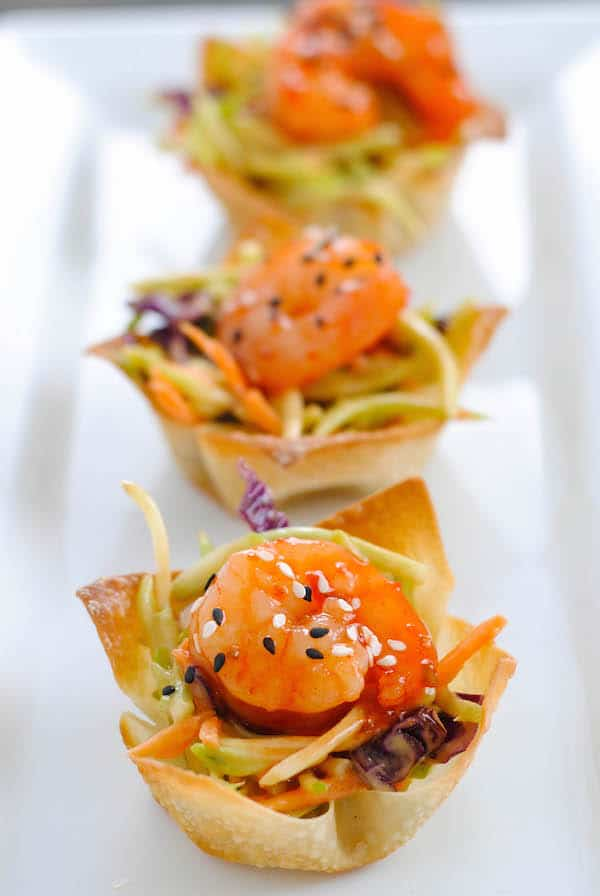 Asian Shrimp Wonton Cups - Crunchy wonton cups filled with broccoli slaw and topped with sweet chili glazed shrimp. Special yet incredibly simple! | foxeslovelemons.com