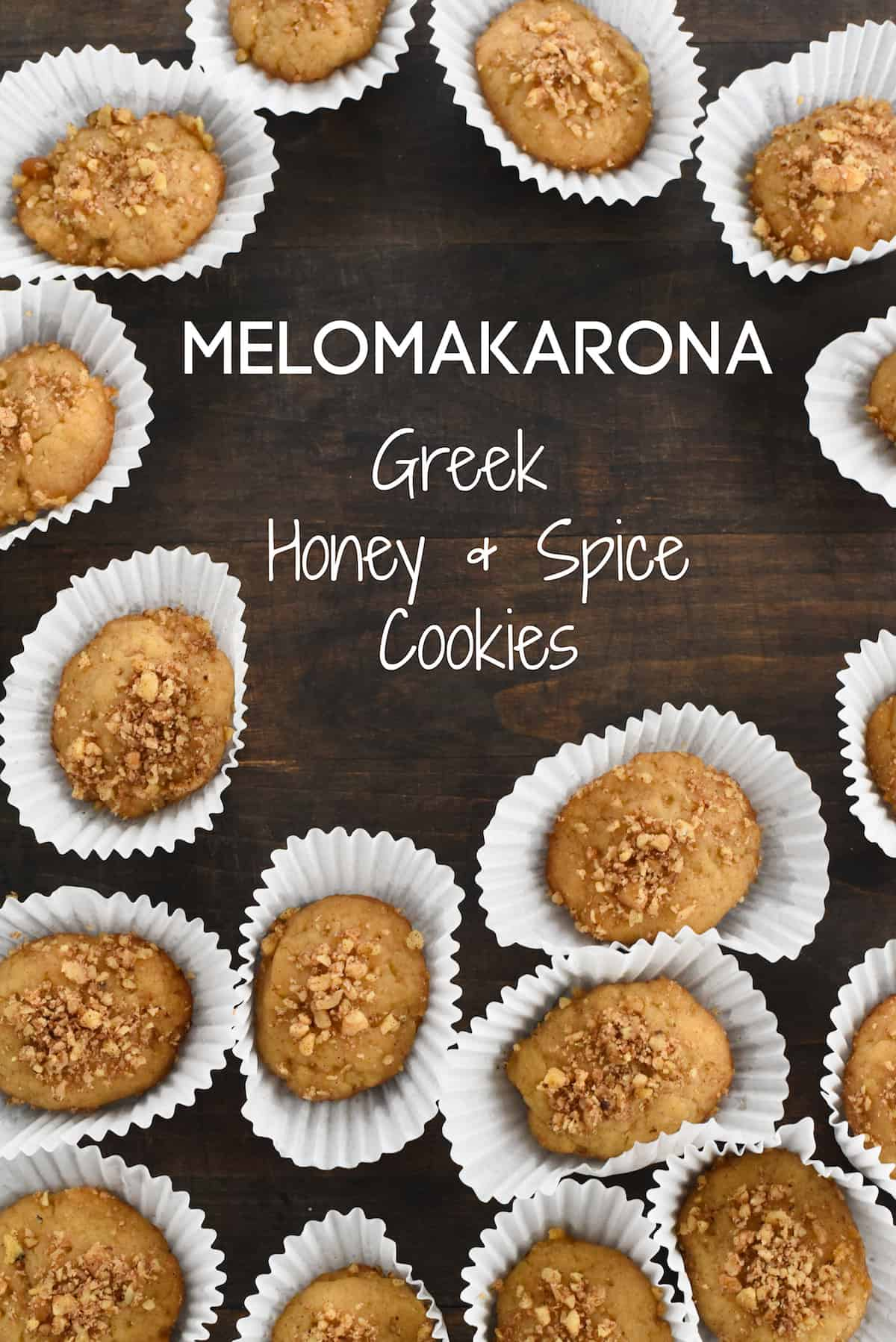 This Melomakarona recipe creates a large batch of Greek Honey & Spice Cookies. Flavored with walnut, spices, orange and honey, these amazing cookies stay fresh up to two weeks! | foxeslovelemons.com