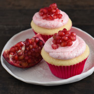 Almond & Pomegranate Cupcakes - Fluffy almond-flavored white cupcakes topped with creamy pomegranate-infused frosting.   foxeslovelemons.com