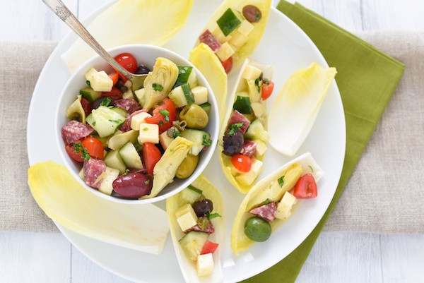 Antipasto Salad Endive Boats - Ditch the old-school relish tray and serve these no-fuss endive boats filled with your favorite meats, cheeses, olives and veggies!   foxeslovelemons.com