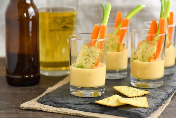 Beer Queso Dip Shooters - Silky smooth queso dip that STAYS silky smooth as it cools!   foxeslovelemons.com