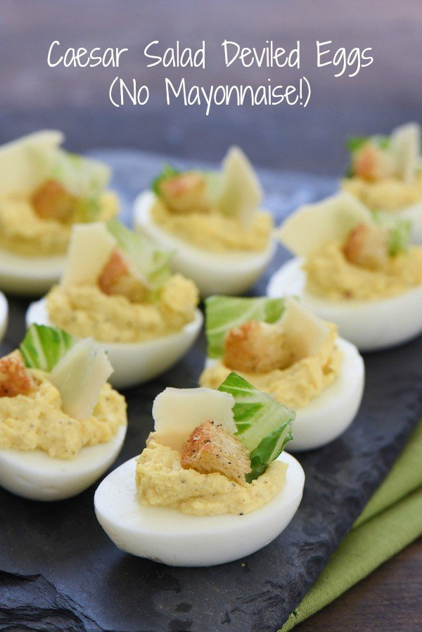 Caesar Salad Deviled Eggs - For this fun take on deviled eggs, egg yolks are mixed with classic Caesar salad flavors and Greek yogurt. If desired, garnish with lettuce, shaved Parmesan cheese and a crouton! | foxeslovelemons.com