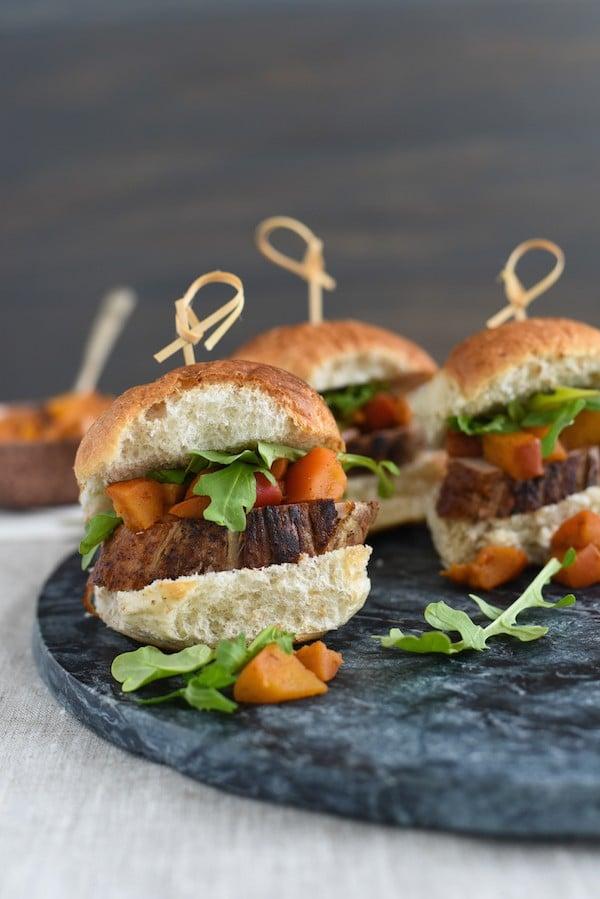 Pork Tenderloin Sliders with Spiced Apple Compote - Seared pork tenderloin topped with spiced cooked apples and peppery arugula. Serve as a party bite or a light dinner! | foxeslovelemons.com