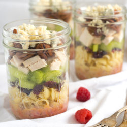 Sonoma Chicken Pasta Salad Jars - Portable and delicious lunches packed with pasta, dried cranberries, celery, chicken, pecans, blue cheese and homemade raspberry vinaigrette! | foxeslovelemons.com
