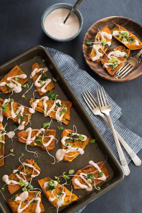 Tandoori Sweet Potato Skins -  A unique party bite or side dish! Crispy sweet potato skins are drizzled with tandoori-flavored yogurt sauce. | foxeslovelemons.com
