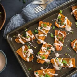 Tandoori Sweet Potato Skins - A unique party bite or side dish! Crispy sweet potato skins are drizzled with tandoori-flavored yogurt sauce. | foxeslovelemons.com