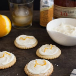 Bourbon Old Fashioned Cocktail Cookies - All the flavors of an Old Fashioned cocktail in a cookie. Sugar cookies flavored with orange zest, topped with bourbon cream cheese frosting! | foxeslovelemons.com