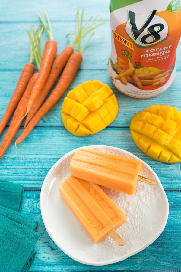 Carrot Mango Frozen Yogurt Pops - A healthful frozen novelty kids will love. Add a splash of rum for the adults! | foxeslovelemons.com