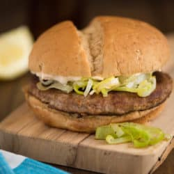 """Good Night & Good Leek Burger - An homage to """"Bob's Burgers."""" Grilled turkey burgers topped with sauteed leeks, and a lemon, caper and Parmesan cheese mayonnaise.   foxeslovelemons.com"""