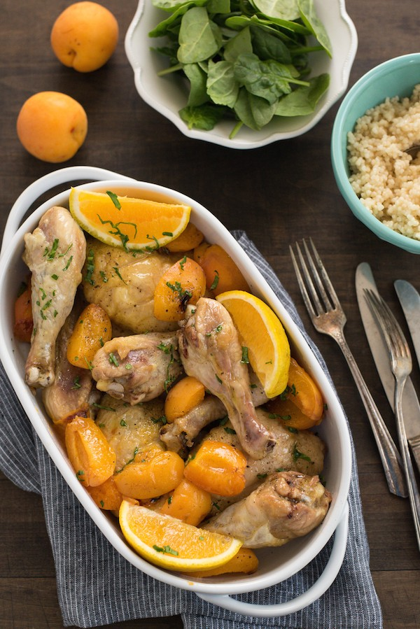 Orange Roasted Chicken & Apricots - A few simple ingredients come together to create this flavorful and healthful weeknight meal! Roasted chicken and roasted fresh apricots are finished with fresh orange juice. Add couscous and a salad, and dinner is served! | foxeslovelemons.com