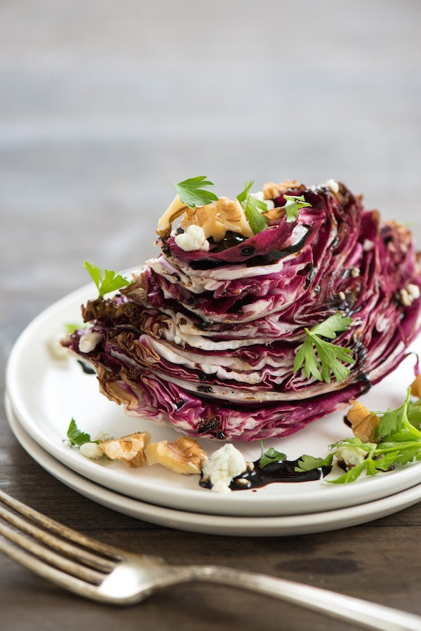 Roasted Radicchio Wedge Salad - A new take on a classic wedge salad. Radiccho is roasted until just tender, then topped with a balsamic vinegar reduction, blue cheese and parsley. | foxeslovelemons.com