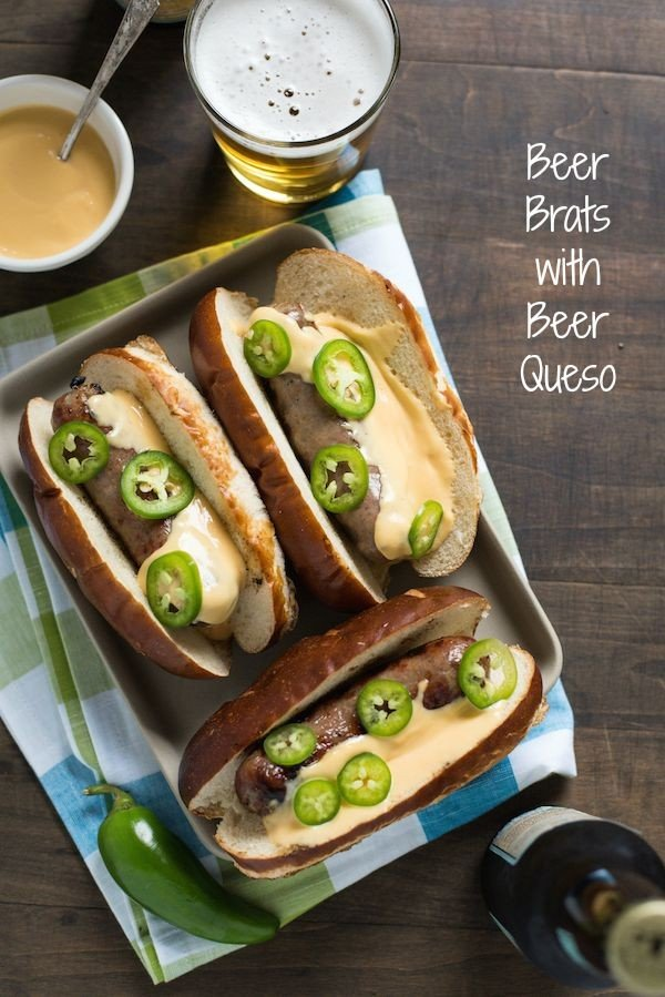 Beer Brats with Beer Queso - For the beer and grilling lovers in your life! Beer-flavored bratwurst topped with a sharp cheddar-beer queso. Serve with beer!   foxeslovelemons.com