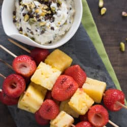 Grilled Fruit Kabobs with Cannoli Dip - Grilled strawberry and pineapple kabobs, with creamy ricotta dip studded with pistachios and mini chocolate chips. | foxeslovelemons.com