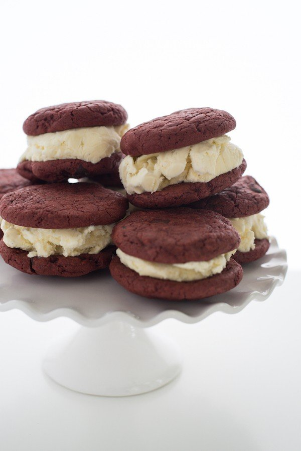 Red Velvet Cookie Ice Cream Sandwiches - Chewy cocoa and chocolate chip cookies sandwiched with cream cheese-vanilla bean ice cream! | foxeslovelemons.com