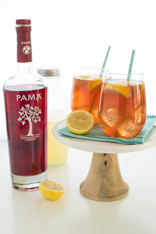 Spiked Pomegranate Arnold Palmer - A twist on the classic iced tea/lemonade drink, spiked with pomegranate liqueur. | foxeslovelemons.com
