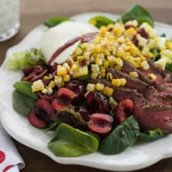 Grilled Flank Steak Salad with Fresh Cherry Vinaigrette - Celebrate two late summer favorites - fresh cherries and sweet corn - in this grilled flank steak salad with fresh mozzarella cheese, hard boiled eggs and homemade cherry vinaigrette. | foxeslovelemons.com