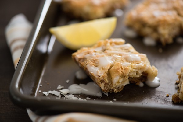 Lemon Coconut Dream Bars -  A tropical treat that will whisk you away to an island! Graham cracker crust is topped with a lemon-infused coconut and almond topping, and a lemon glaze.   foxeslovelemons.com