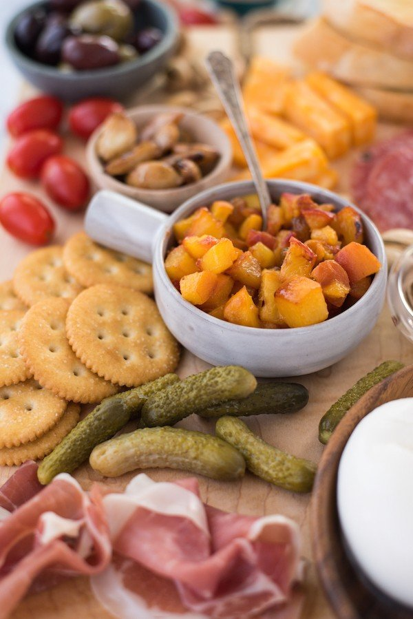 """Summer Cheese & Charcuterie Board with Spicy Peach Chutney - Use a little help from your grocery store, pile everything onto a big cutting board and serve dinner """"platter"""" style. Fresh summer peaches make a super-easy Spicy Peach Chutney.   foxeslovelemons.com"""