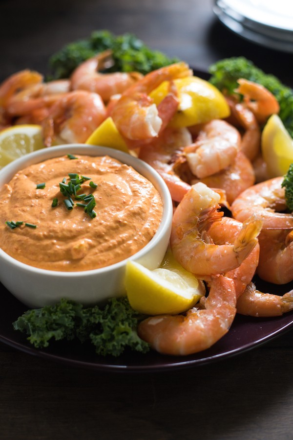 Roasted Lemon Shrimp Cocktail with Piquillo Pepper Dip - A Spanish-inspired twist on classic peel-and-eat shrimp cocktail. Serve as an appetizer at your next party and watch it disappear! | foxeslovelemons.com