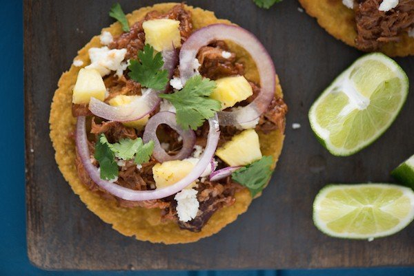 Slow Cooker Hawaiian Pulled Pork Tostadas - Few ingredients, minimal prep time, HUGE flavors! Let your crockpot do all the work for this family-friendly meal. | foxeslovelemons.com