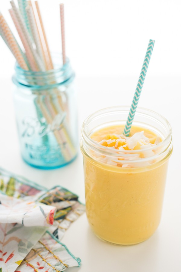 Tropical Sun Smoothie - Wake up your taste buds with this quick and healthful blender breakfast - a combination of pineapple, mango, banana, coconut and vanilla yogurt. | foxeslovelemons.com