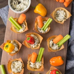 Veggie & Dip Wonton Cups - A veggie and dip tray, in adorable personal-sized portions! Edible wonton wrapper cups are filled with creamy dip and topped with fresh veggies. | foxeslovelemons.com