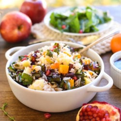 Autumn Celebration Rice Salad - A gluten-free and vegetarian holiday side dish option, loaded with butternut squash, pomegranate, swiss chard, dried cranberries, apples and pistachios, tossed with homemade apple cider vinaigrette! | foxeslovelemons.com