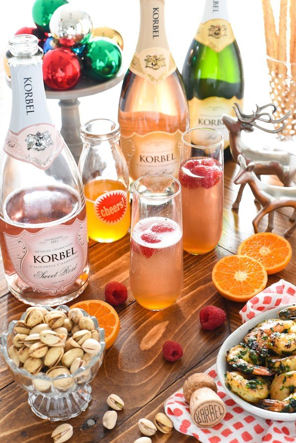 Clementine & Raspberry Rosé Fizz - A sweet and fun bubbly cocktail perfect for brunch! | foxeslovelemons.com