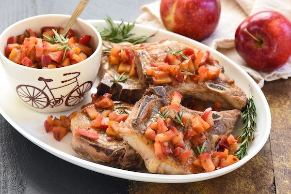 Pork Chops with Spicy Applesauce - An updated take on a classic favorite. Just a handful of ingredients come together to create this simple and healthful meal! | foxeslovelemons.com