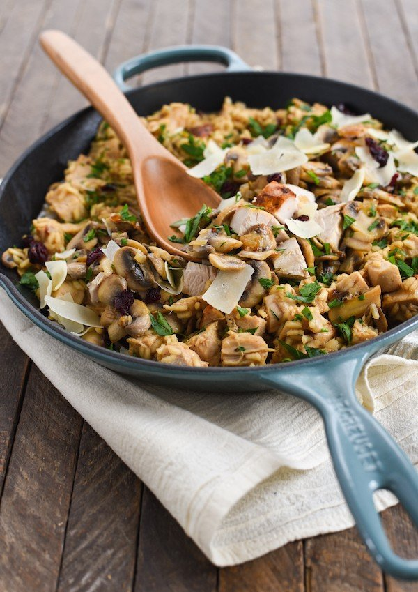Turkey, Mushroom & Cranberry Risotto - Pure winter comfort food in a skillet. Arborio rice, sautéed mushrooms, turkey breast, dried cranberries and Parmesan cheese come together in this creamy, dreamy rice dish. | foxeslovelemons.com