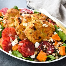 Almond-Crusted Chicken Thighs with Winter Wild Rice Salad - A big platter of winter comfort food masquerading as a salad. Feast your eyes, and your tastebuds, on this healthful, beautiful meal. | foxeslovelemons.com