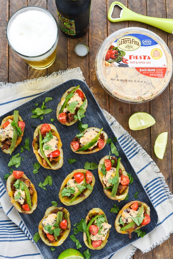 Fiesta Chorizo & Poblano Potato Skins - Crispy potato skins filled with chorizo, cheddar cheese, roasted poblano pepper, tomatoes, cilantro and a creamy Southwestern dip! | foxeslovelemons.com