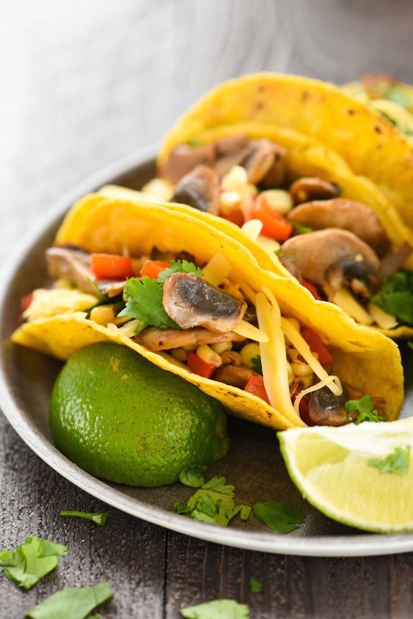 Mushroom & Gouda Tacos - Have $10 and 20 minutes? This healthful but flavorful vegetarian meal can be on your dinner table in a flash!   foxeslovelemons.com