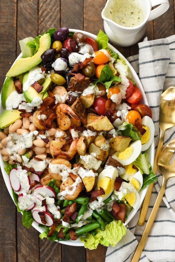 Mega Chopped Salad with Shrimp & Roasted Potatoes - Clean out your fridge and pantry for this salad that is a meal itself. Drizzle with homemade Pesto Ranch Dressing (recipe included). | foxeslovelemons.com