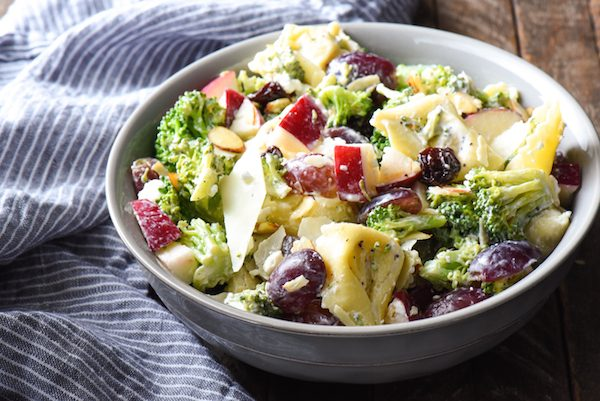 Chopped Broccoli Salad with Cheese Tortellini - A party favorite! Everyone in the crowd will wants seconds of this tortellini salad full of broccoli, cheese, fruit and nuts. | foxeslovelemons.com