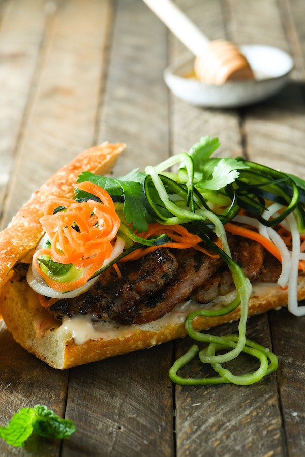 Honey Grilled Pork Banh Mi with Spiralized Pickled Vegetables - Prep ahead for an assemble-and-serve weeknight meal. Quick on time, HUGE on Asian flavor. | foxeslovelemons.com