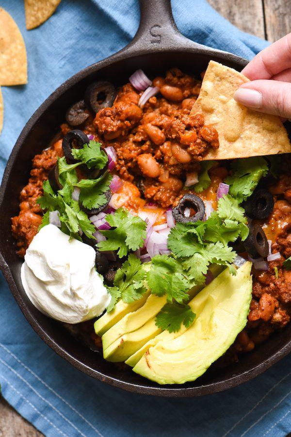 Meaty Enchilada Chili Dip - This dip will keep your party guests coming back with another chip again and again!   foxeslovelemons.com