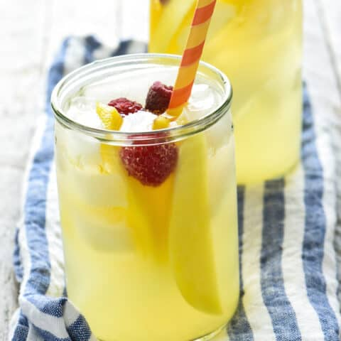 Mango-Pineapple Sangria - This fruit summer drink is a breeze to stir together, can be made in advance, and serves a crowd!   foxeslovelemons.com