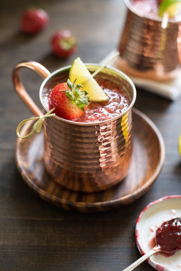 Double Strawberry Moscow Mules - An even more summery twist on a summer cocktail! Jazz up the beloved Moscow Mule with fresh strawberries and strawberry preserves.   foxeslovelemons.com