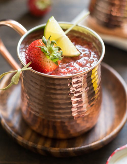 Double Strawberry Moscow Mules - An even more summery twist on a summer cocktail! Jazz up the beloved Moscow Mule with fresh strawberries and strawberry preserves. | foxeslovelemons.com