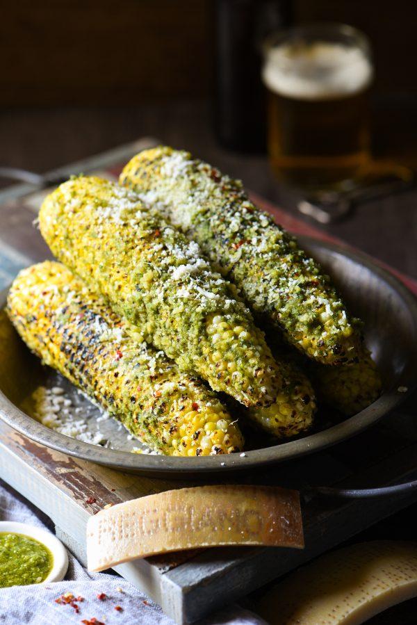 Grilled Parmesan-Pesto Sweet Corn - 4 ingredients. 8 minutes cook time. The best summer side dish ever! | foxeslovelemons.com