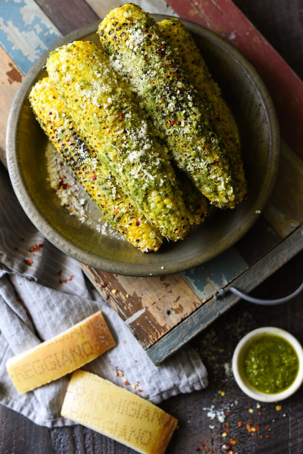 Grilled Parmesan-Pesto Sweet Corn - 4 ingredients. 8 minutes cook time. The best summer side dish ever! | foxeslovelemons.com