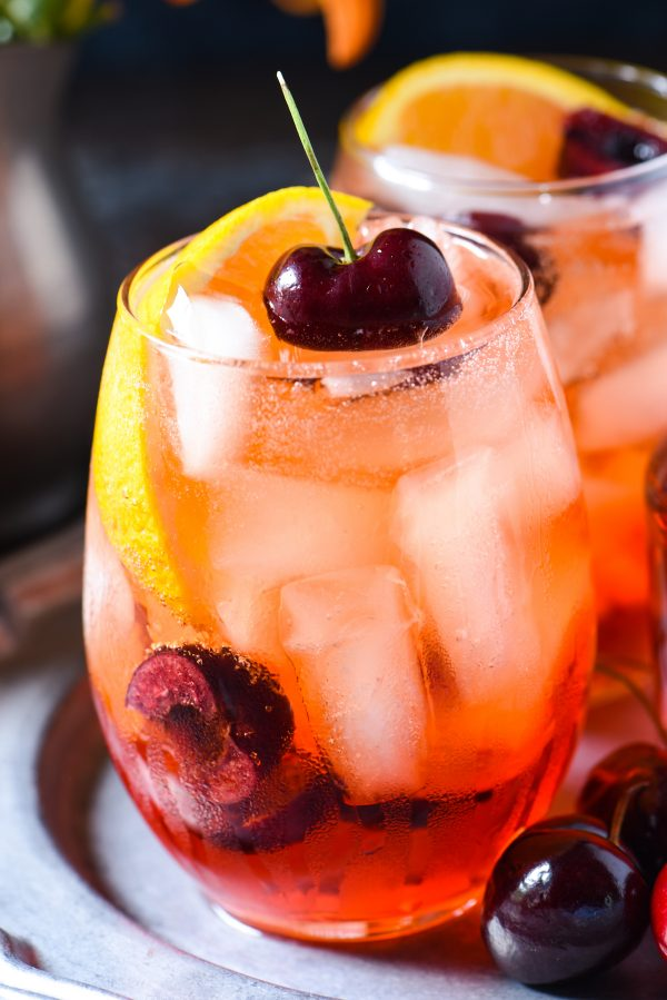 Cherry & Ginger Prosecco Spritz - Stir together this light and refreshing summer cocktail in just 5 minutes! Perfect for a party, or just one! | foxeslovelemons.com