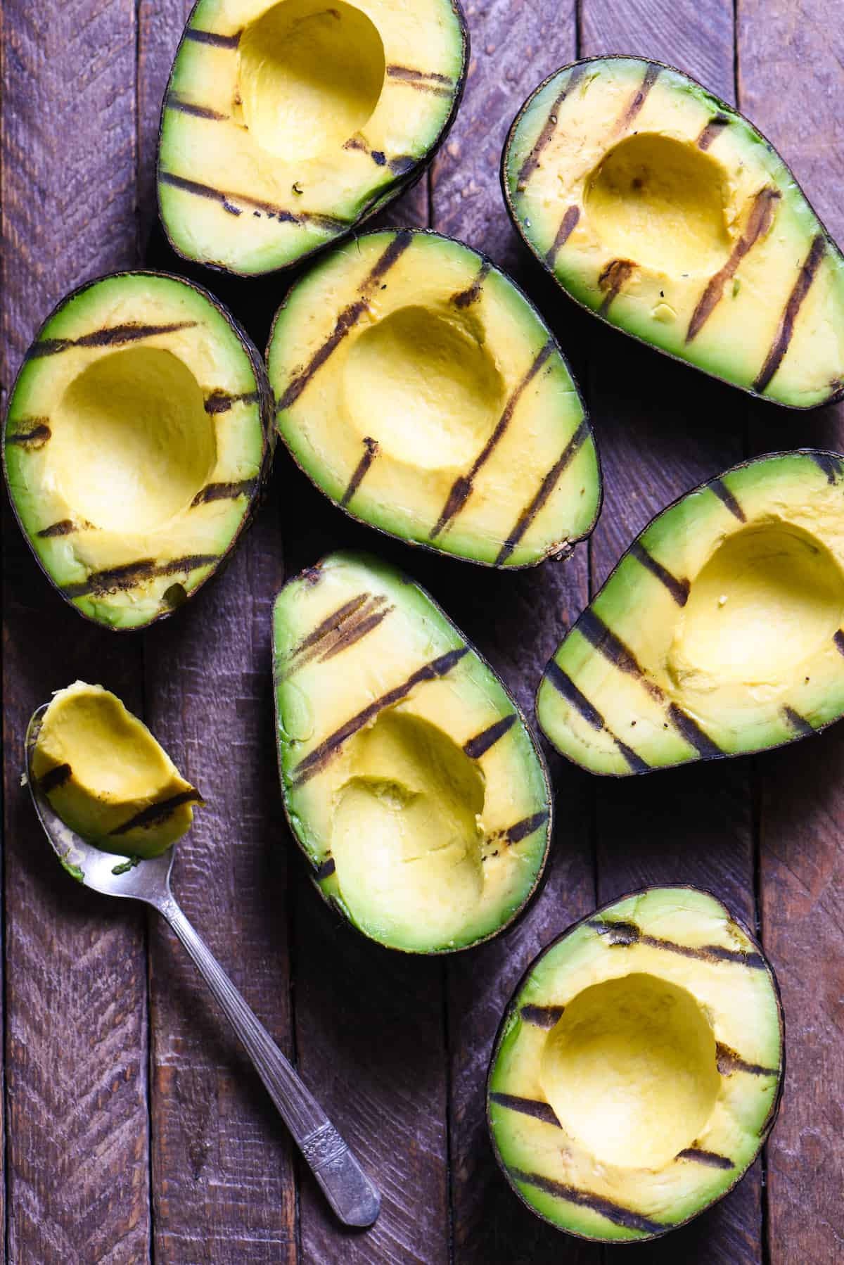 Grilled Avocado Crostini Board - A fun party idea! Pile a bunch of fresh toppings onto a big platter, and let your guests assemble their own grilled avocado crostini!   foxeslovelemons.com