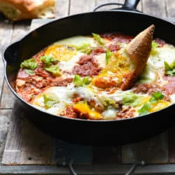 Bloody Mary Shakshuka - Horseradish-infused tomatoes topped with soft eggs. Serve with crusty bread for a quick, easy and very affordable meal! | foxeslovelemons.com